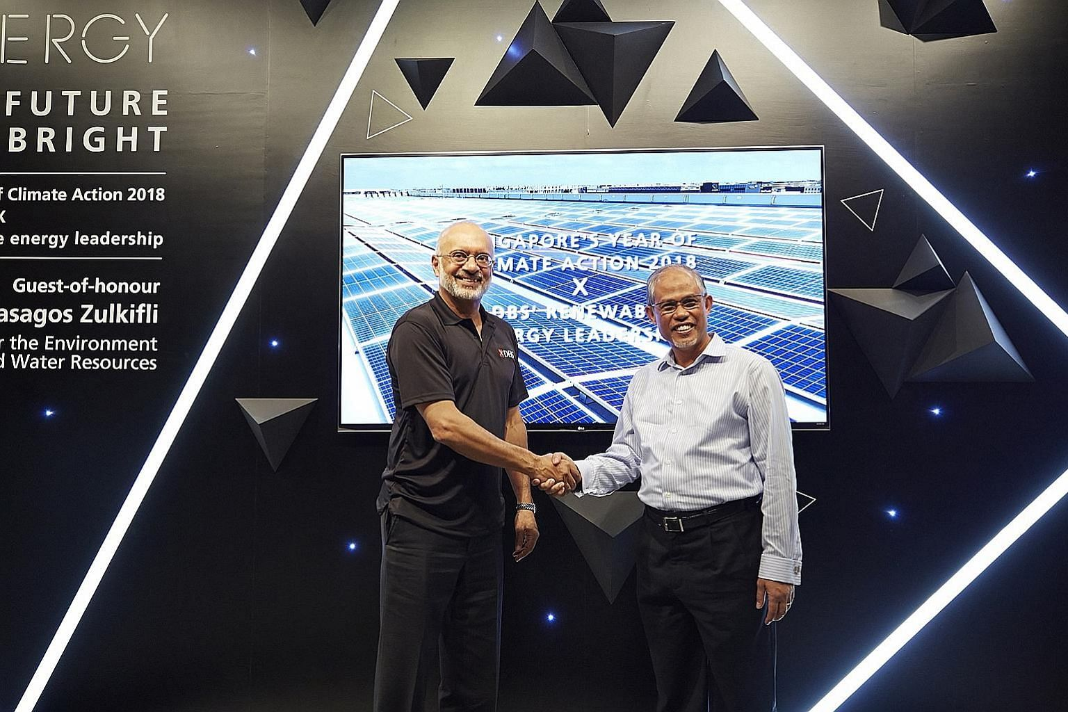 DBS chief executive Piyush Gupta (left) and Minister for the Environment and Water Resources Masagos Zulkifli at the launch of a solar energy installation at DBS Asia Hub yesterday.