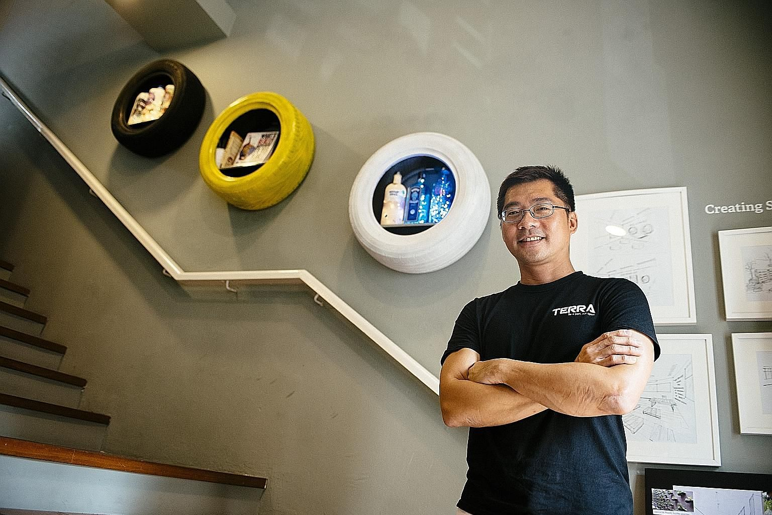 Social enterprise Terra SG, co-founded by Eric Oh (top), sells upcycled products such as coin pouches made from drinks cartons (above) and lights made from vodka bottles (left).
