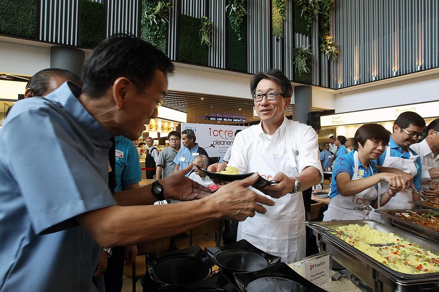 Mr Lim Swee Say serving food to cleaners at an event organised by NTUC in June 2013 to show appreciation for them. The 63-year-old is retiring as Manpower Minister after a 21-year career in politics.