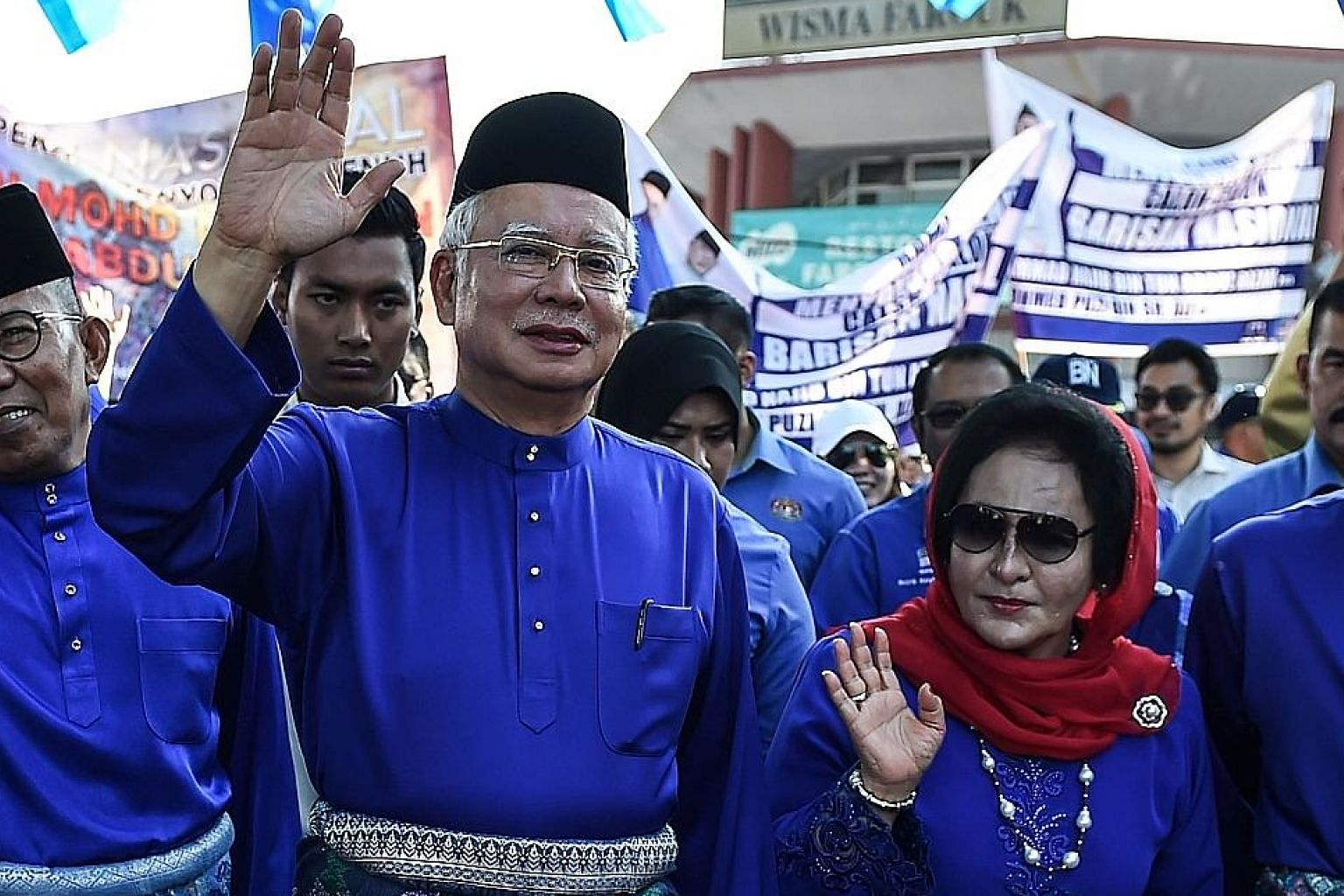Malaysia's Prime Minister Najib Razak, with his wife Rosmah Mansor, arriving at the nomination centre to submit his election documents in Pekan, Pahang, yesterday.