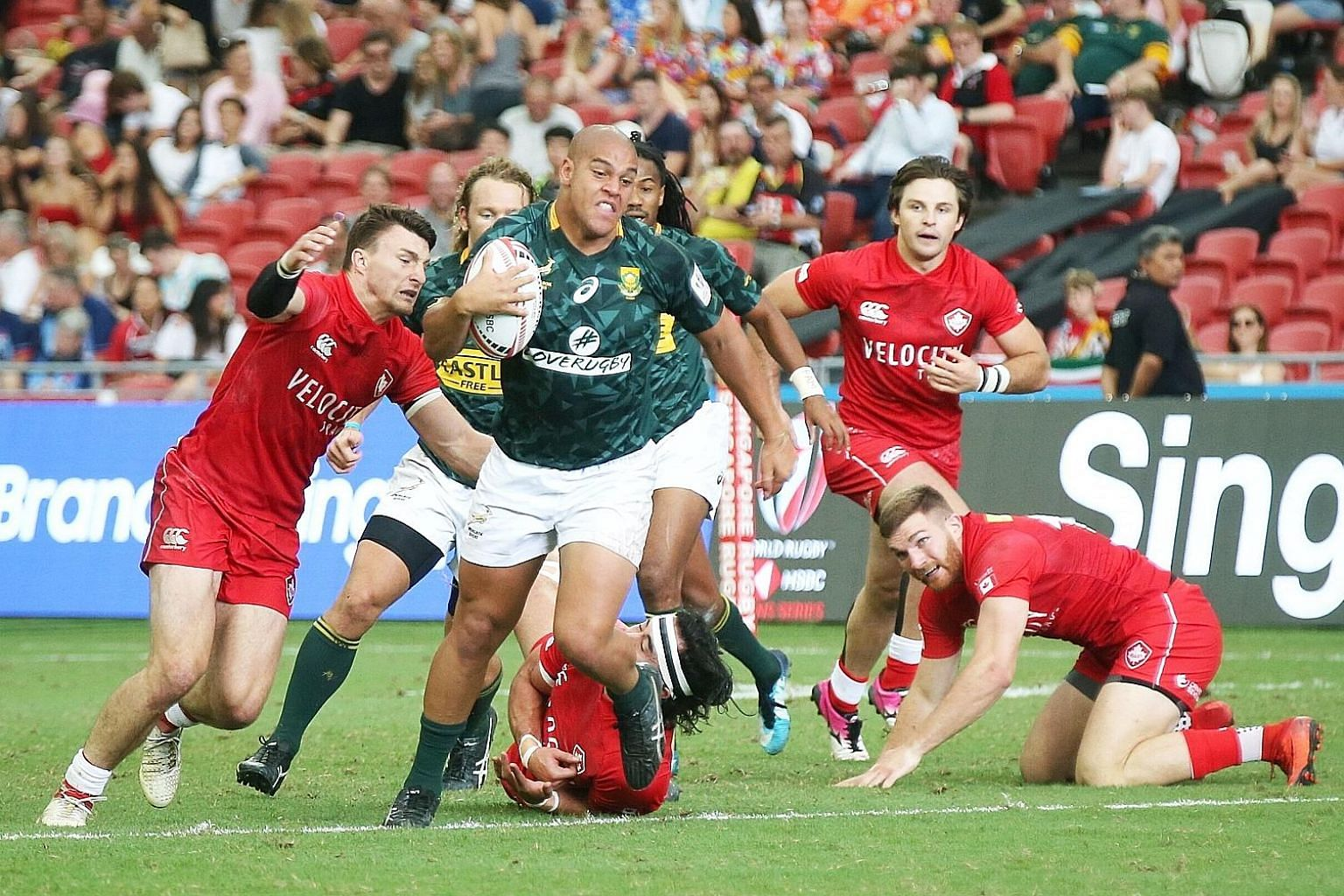 South Africa's Zain Davids makes ground against Canada in the HSBC World Rugby Sevens Series at the National Stadium yesterday. Canada, the defending champions, were beaten 26-12.