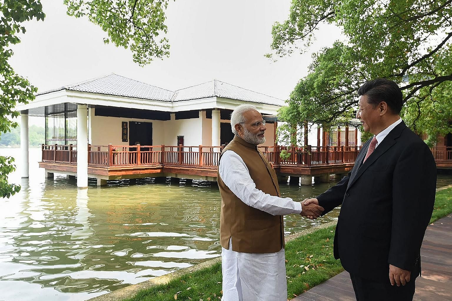 """Chinese President Xi Jinping with Indian PM Narendra Modi at Wuhan's East Lake. The two leaders issued """"strategic guidance to their respective militaries"""" to strengthen communication and build trust, and both sides agreed to handle differences with m"""