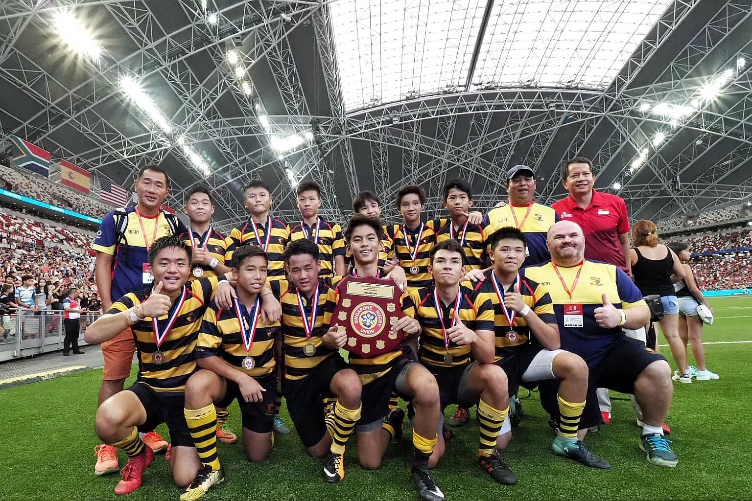 ACS(I) captain Ng Zu Jie (with shield) led his team to victory over St Andrew's in the U-14 Singapore Schools Sevens Series.