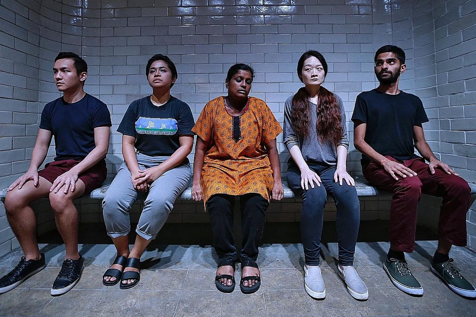 The cast of 0600, including (from far left) Jeramy Lim, Suhaili Safari, Grace Kalaiselvi, Lina Yu and Vignesh Singh, takes viewers on a journey tracing the prisoners' route through the former Supreme Court building.