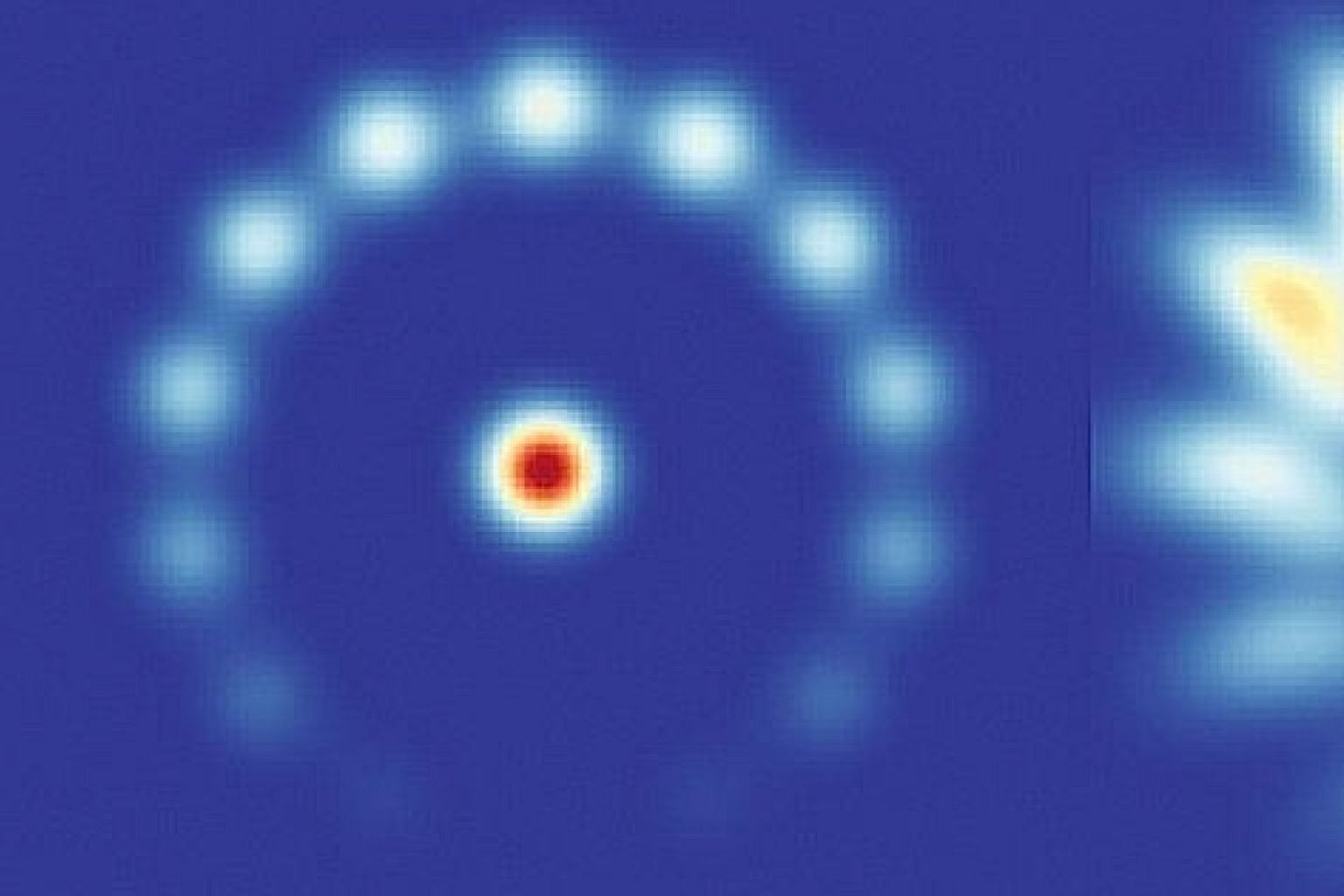 """These """"flowering"""" patterns show a computer simulation of a cold atom system in action. As thousands of atoms are cooled to a temperature near absolute zero, they are shaped into a ring. The atoms are concentrated into a central pool and a corrugated"""