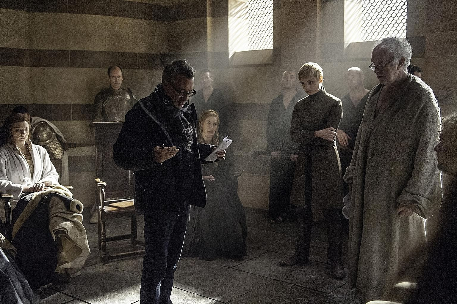 Film-maker Jeremy Podeswa in a scene from Game Of Thrones with actors (seated from far left) Natalie Dormer, Lena Headey, (standing) Dean-Charles Chapman and Jonathan Pryce.
