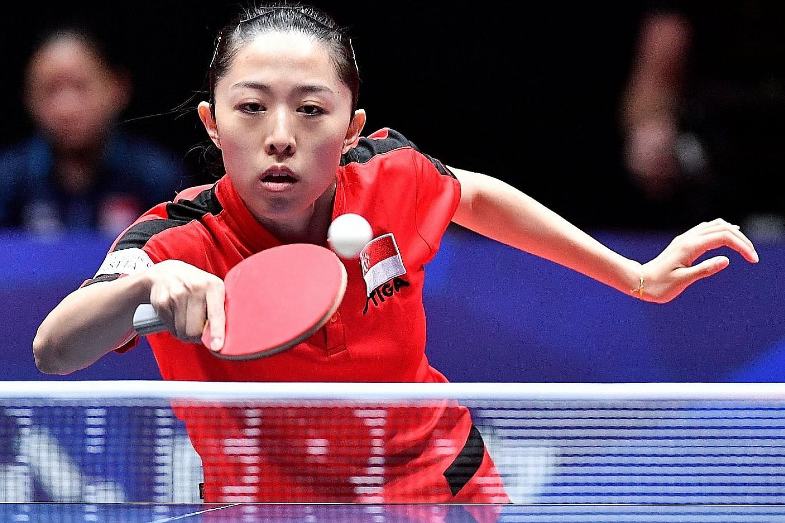 National paddler Yu Mengyu returning a shot against Ukraine's defensive specialist Ganna Gaponova yesterday. She carried a shoulder injury into the Halmstad Arena in Sweden and lost both her matches in the last-16 tie.