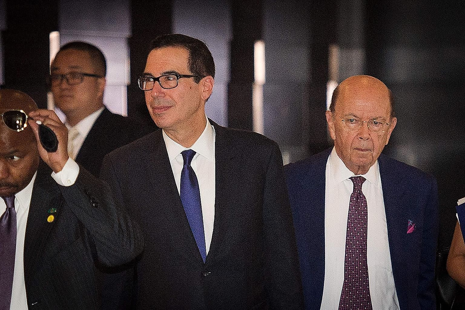 US Treasury Secretary Steven Mnuchin (far left) and Commerce Secretary Wilbur Ross in Beijing yesterday. The US delegation was in China to soothe trade tensions after both sides threatened to slap additional tariffs worth billions of dollars on each