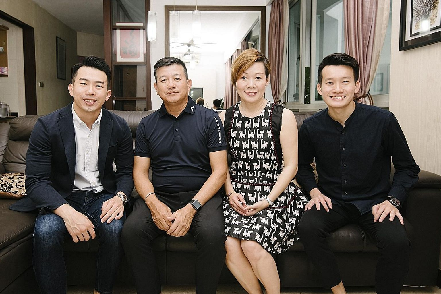 ERA branch division director Ryan Lee (left), with his parents Benson Lee, 57, and Peggy Lim, 51, and his younger brother, Kah Liang, 25, who has joined him in the property business. He has consistently been one of ERA's top 5 per cent of real estate agen