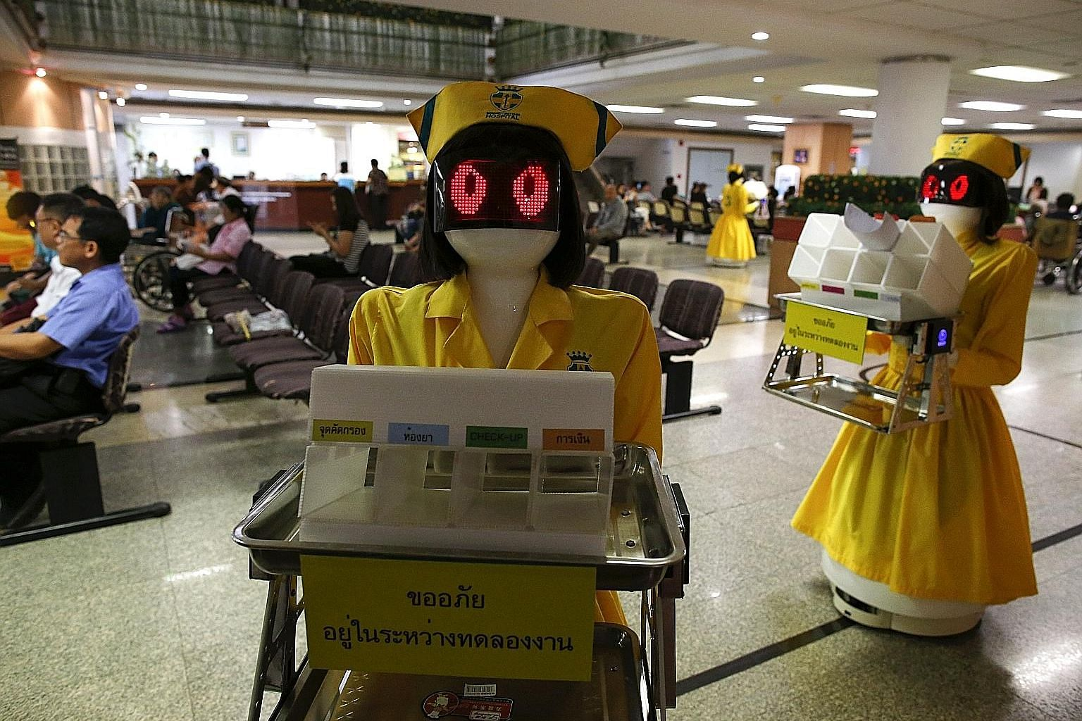 Automated Guided Vehicles, dressed in nurse costumes, at Mongkutwattana General Hospital in Bangkok. The Thai hospital uses three such robots as document couriers to save hiring costs and tackle a shortage of staff. MAS noted that digital transformat