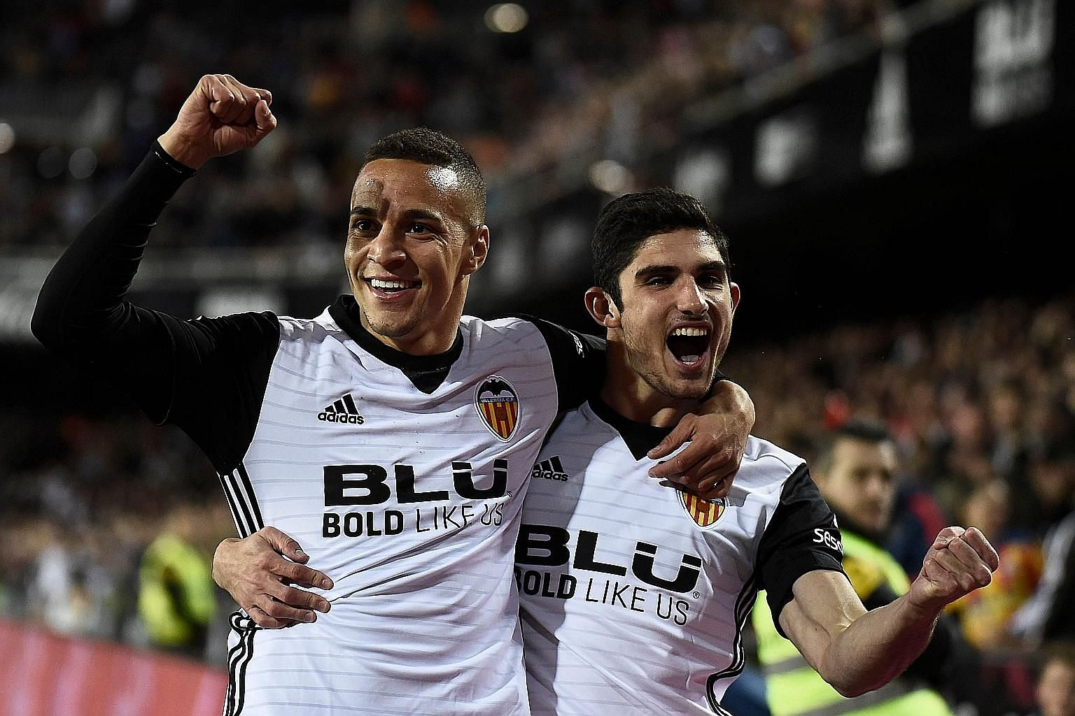 Rodrigo Moreno (far left, with midfielder Goncalo Guedes) has powered Valencia's bid for Champions League football with 16 LaLiga goals this season. Striker Santi Mina, 22 (below), with 12 league goals in 17 games, is one of the young guns who have i