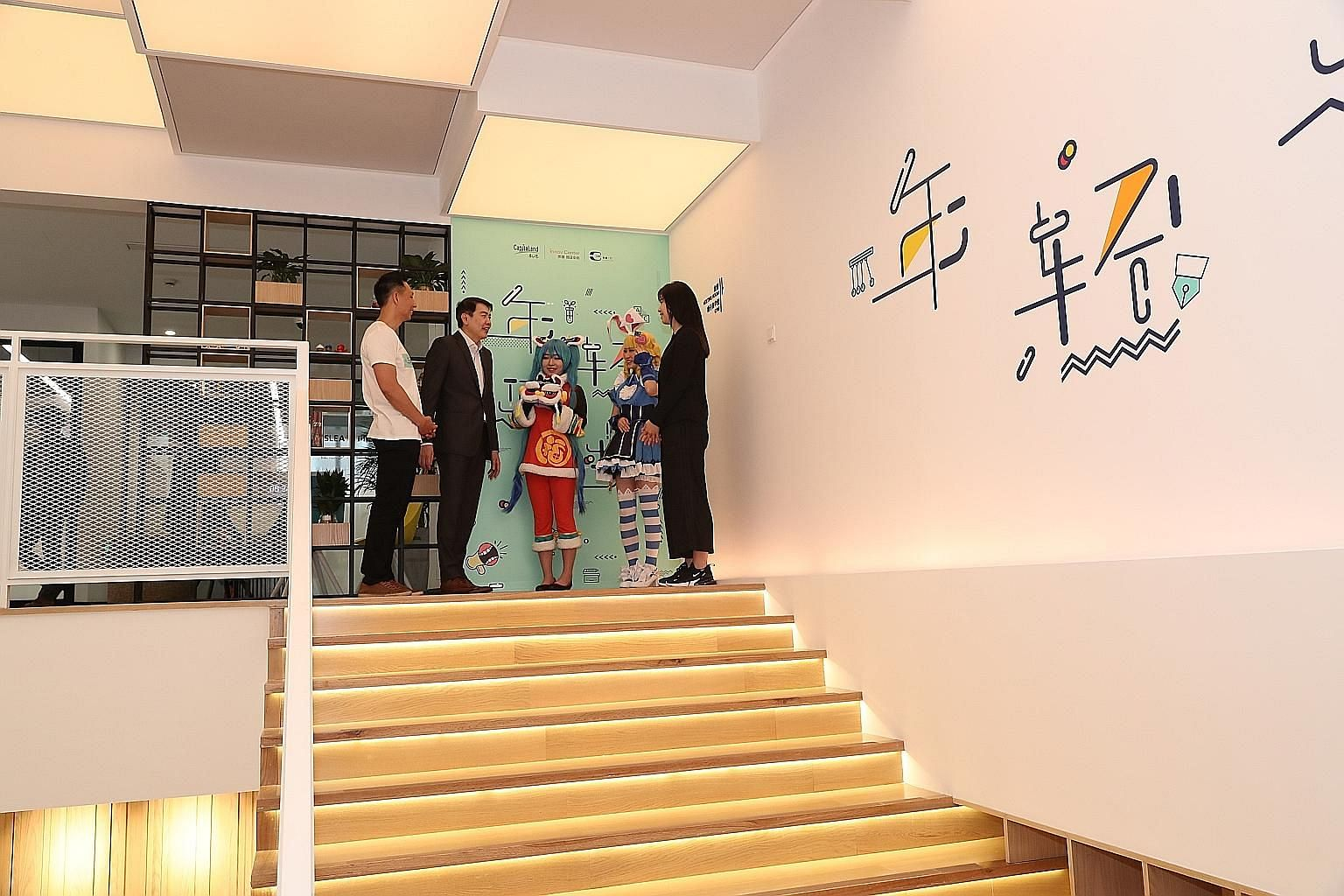 CapitaLand president and group chief executive Lim Ming Yan (in black jacket) with Ms Lufier Wang, vice-president and founder of Fighting.S and her crew. Fighting.S is a tenant of C3 specialising in cosplay events and talent management. The space has