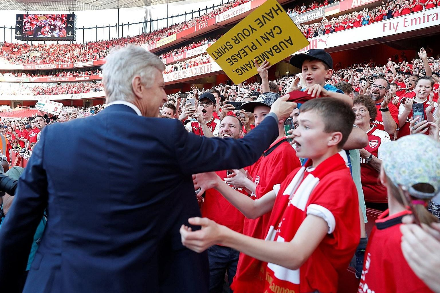 From top: Arsenal's French manager Arsene Wenger giving his tie to a young fan who had a placard with the words - Arsene, can I have your tie - during the lap of honour after Sunday's 5-0 win over Burnley. Wenger receiving a guard of honour from the