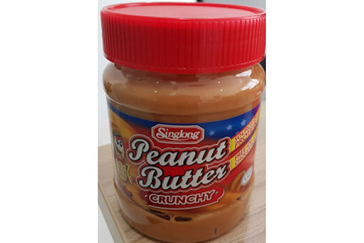 After a metal screw was found in a bottle of peanut butter, the importer recalled the batch as a precautionary measure.