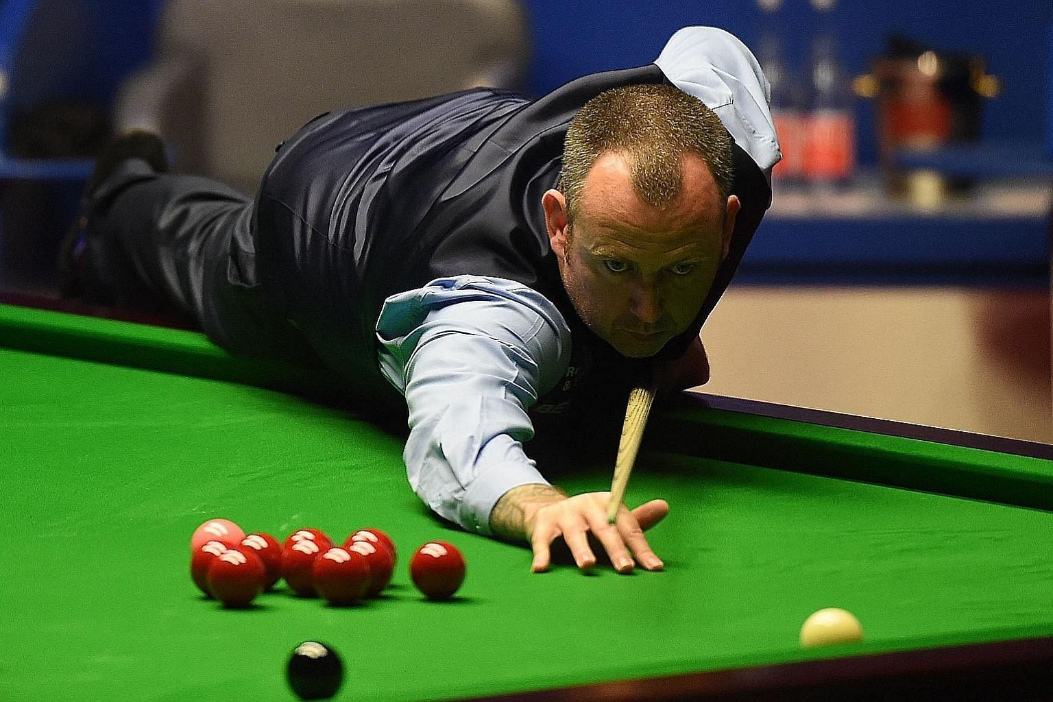 From top: Welshman Mark Williams attending his press conference naked after winning his third world title. Mark Williams playing a shot against Scotland's John Higgins during the World Championship Snooker final match at The Crucible in Sheffield, En
