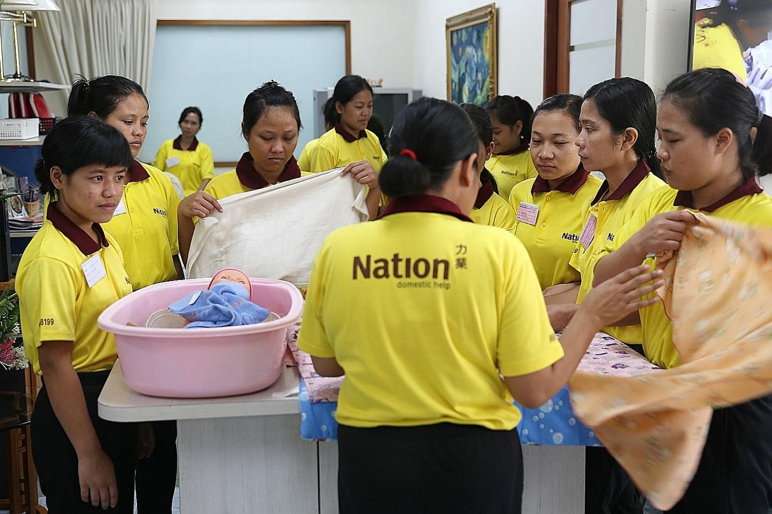 Maids being trained at an employment agency here. The new performance bond of $6,000 imposed by the Indonesian Embassy on employers here who hire maids from Indonesia took effect last month.
