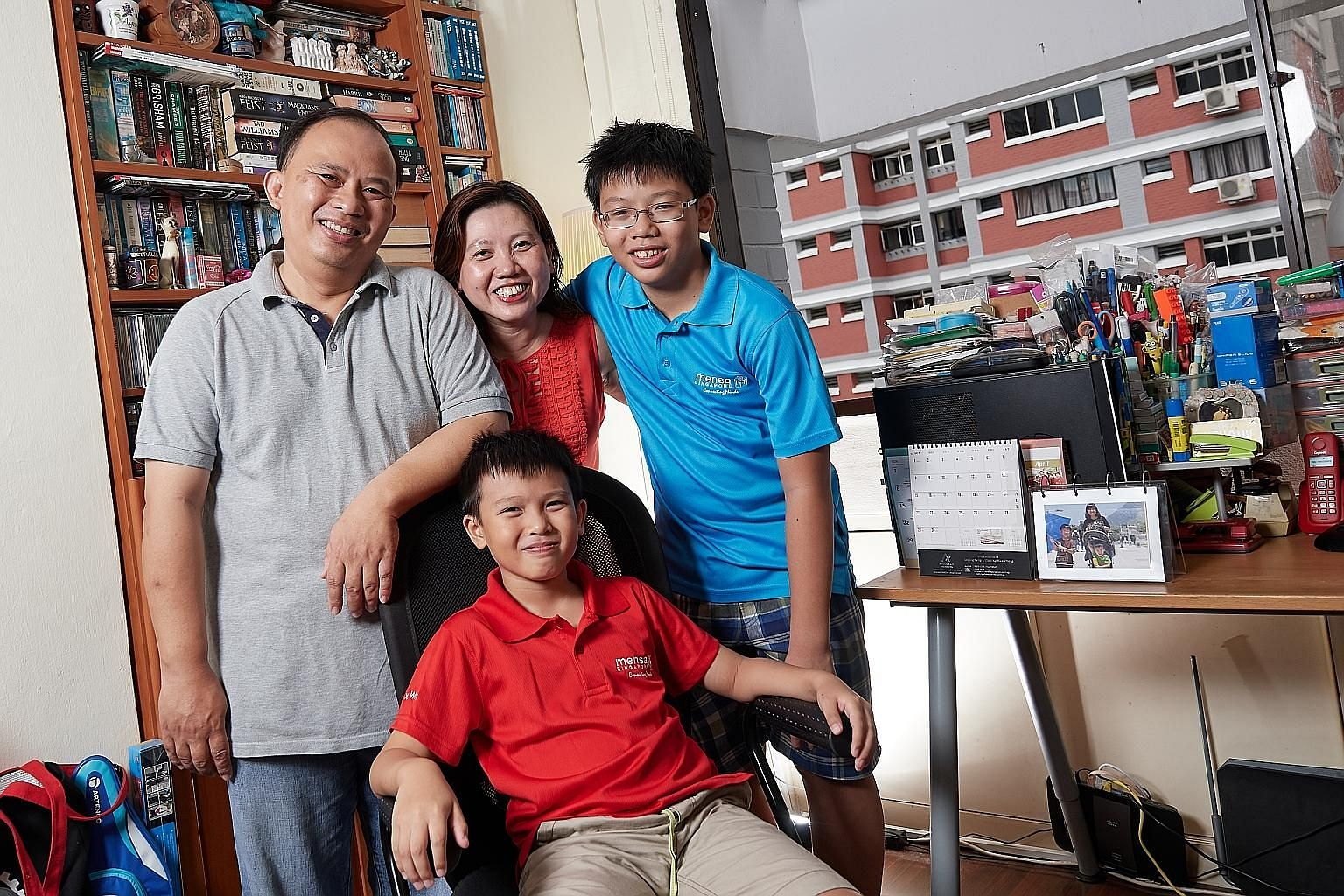 Xavier Wong (seated), 10, with his parents Anthony Wong and Angela Lee, and older brother Zachary. Xavier can solve maths problems meant for children two years older than he is and is a member of high-IQ society Mensa. But he also has mild attention-