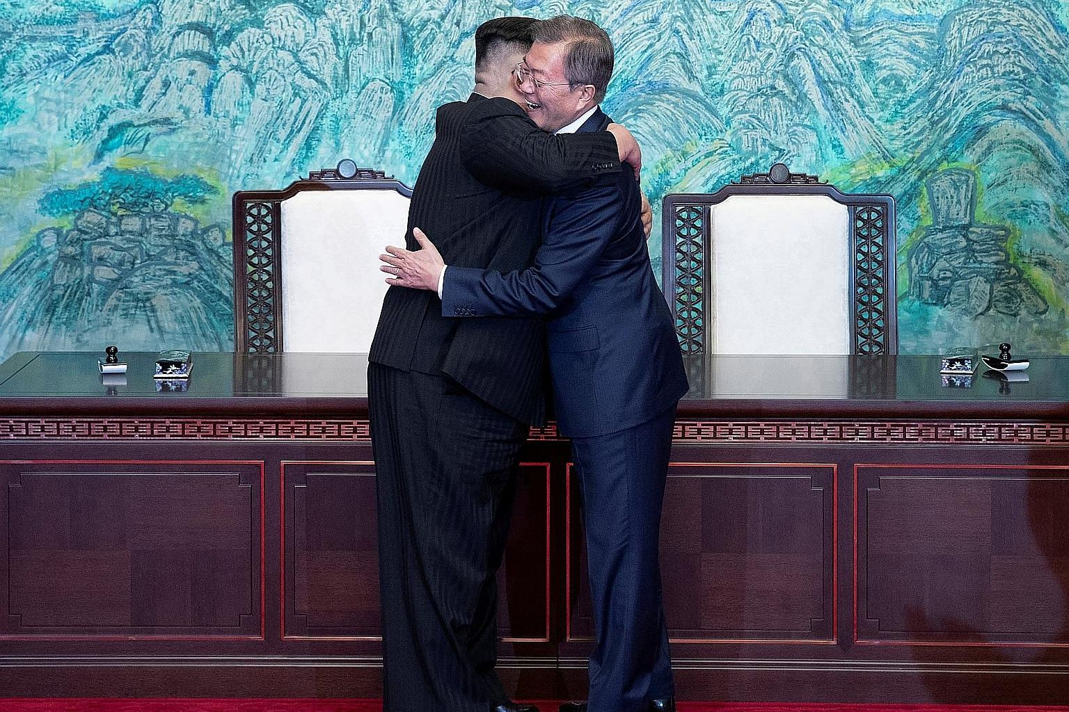 South Korean President Moon Jae In (right) and North Korean leader Kim Jong Un embracing in the truce village of Panmunjom last month.