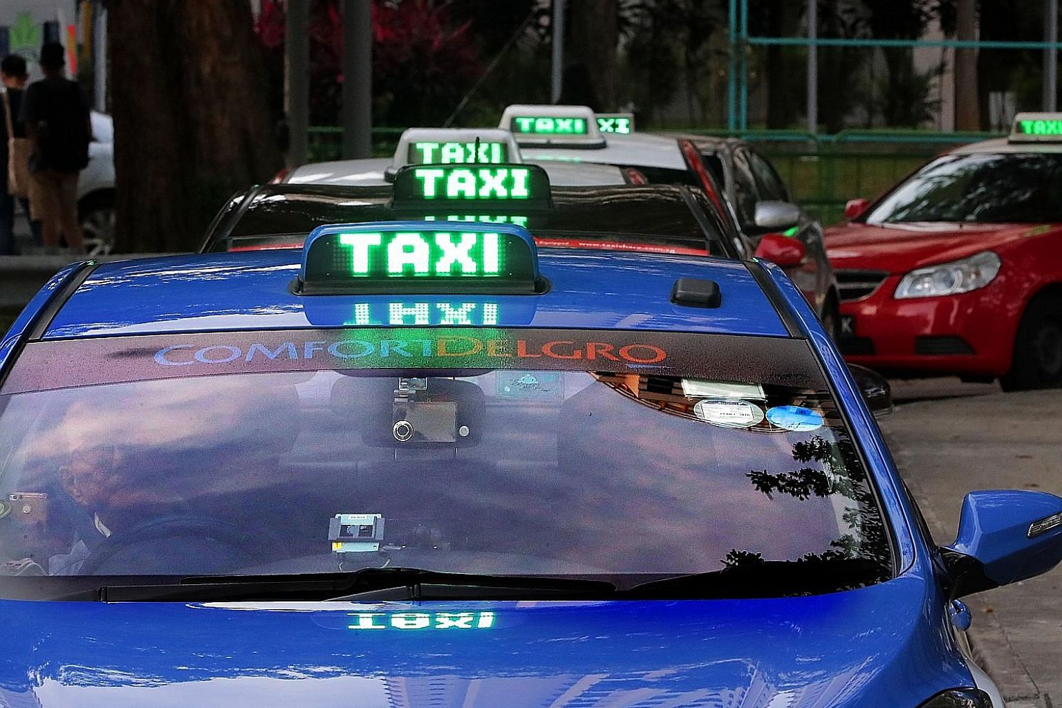 "ComfortDelGro's Singapore taxi business continued to be battered by private-hire players, although there are signs of a turnaround in the second quarter of this year. Directors expect revenue from the taxi business to stabilise with ""the rationalisat"