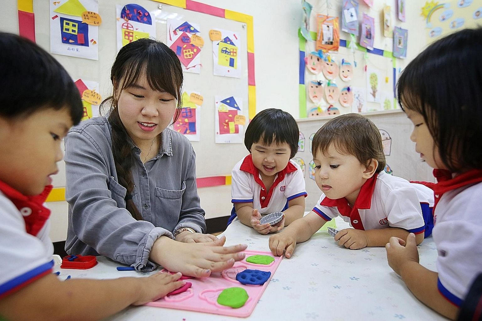 Ngee Ann Polytechnic early childhood education student Jessie Too, 20, having an interactive lesson with children. The new diploma will have a curated set of core modules and a strong focus on practice-based learning.