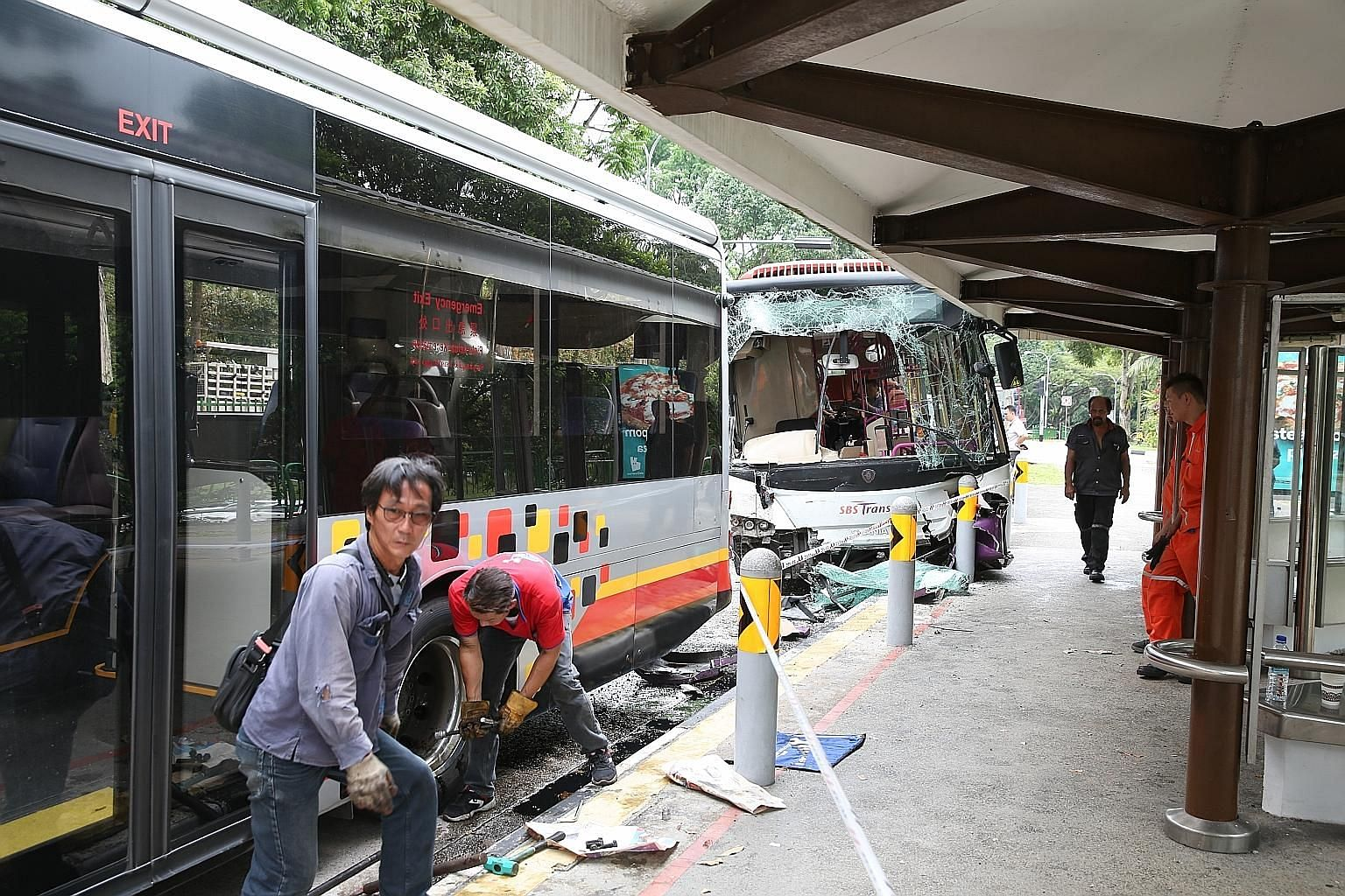 The accident, which happened at a bus stop in Jalan Jurong Kechil at about 9am yesterday, involved SMRT service 970 and SBS Transit service 157. There were no reports of serious injuries.