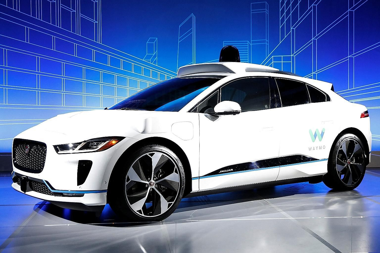 A Jaguar I-Pace self-driving car at its unveiling by Waymo in New York.