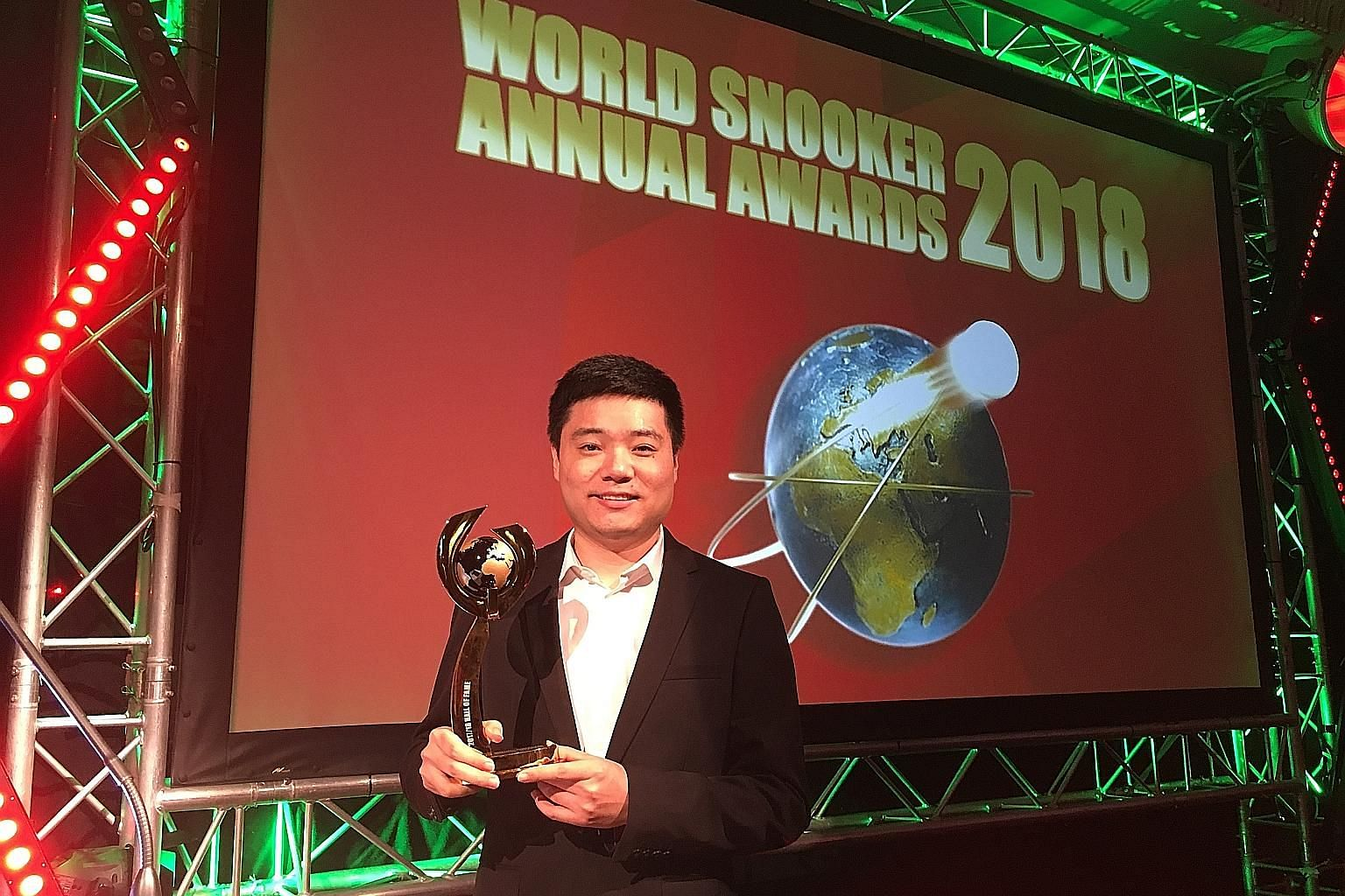 Ding Junhui at the World Snooker Awards ceremony at London's Dorchester Hotel on Thursday. He became the second Asian to be inducted.