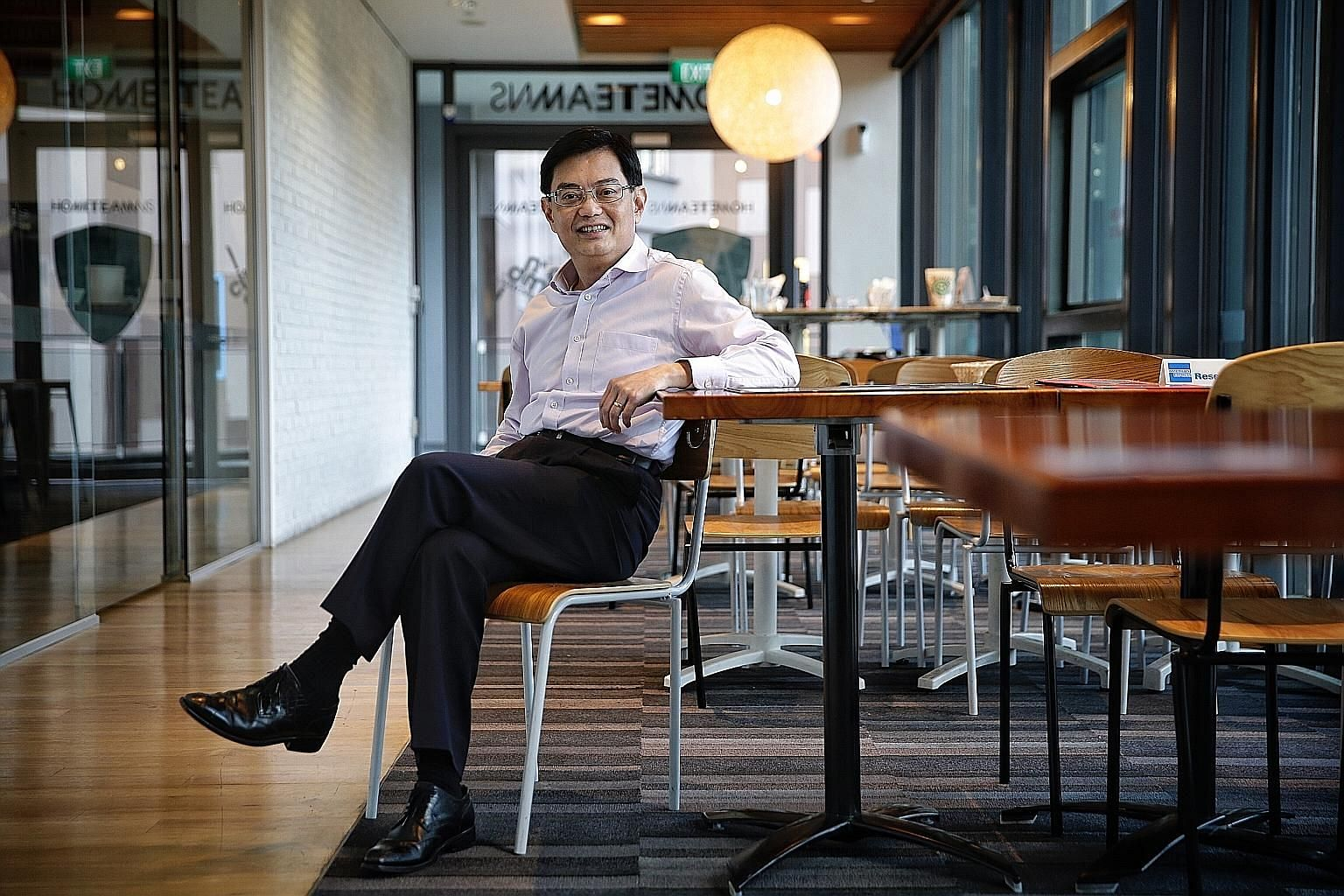 Finance Minister Heng Swee Keat in a cafe at Our Tampines Hub, Singapore's first integrated community and lifestyle destination. The Hub tapped residents' views to re-imagine how space can be used, with facilities grouped together to make them more c