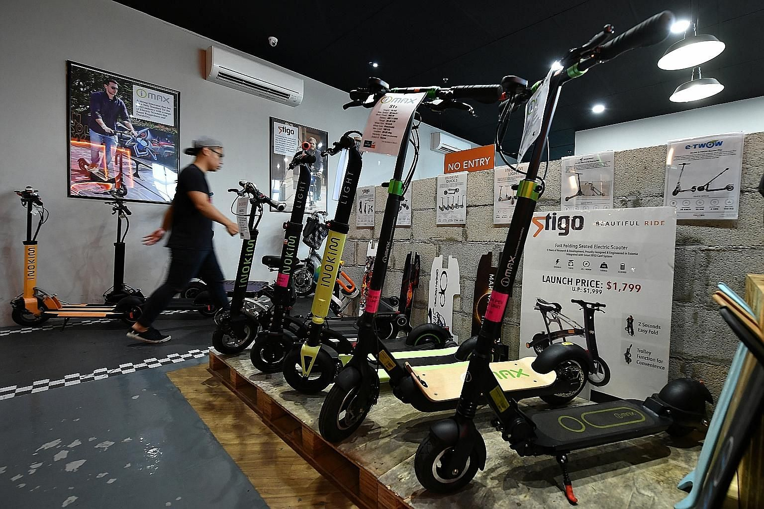 Electric scooters for sale at Falcon PEV. Its general manager Victor Lee said PMD sales have slowed by about 20 per cent, starting from a year ago, and attributed this partly to more retailers entering the market, along with news of the Active Mobili