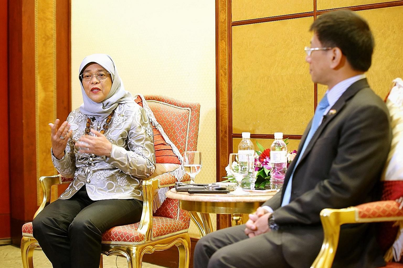 President Halimah Yacob with Singapore's High Commissioner to Brunei, Mr Lim Hong Huai, as she spoke to Singapore reporters at the end of her four-day state visit to Brunei yesterday. On Sunday, Mr Lim hosted a dinner reception for Singaporeans in th