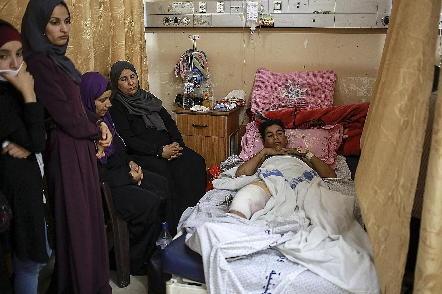 Surgeons from medical charity Doctors without Borders performing surgery at a hospital in Deir al-Balah, Gaza, on a Palestinian man who had received a bullet in his leg during Monday's protests. An alliance of international medical-aid organisations