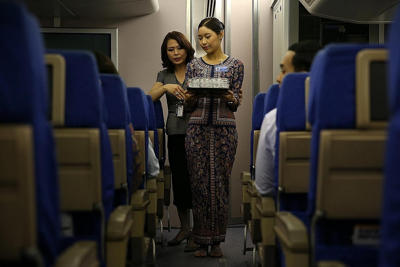 A Singapore Airlines cabin crew trainee at a deportment and etiquette class. The carrier topped the Singapore list for three years from 2012 to 2014, which earned it a spot in recruitment agency Randstad's Hall of Fame.