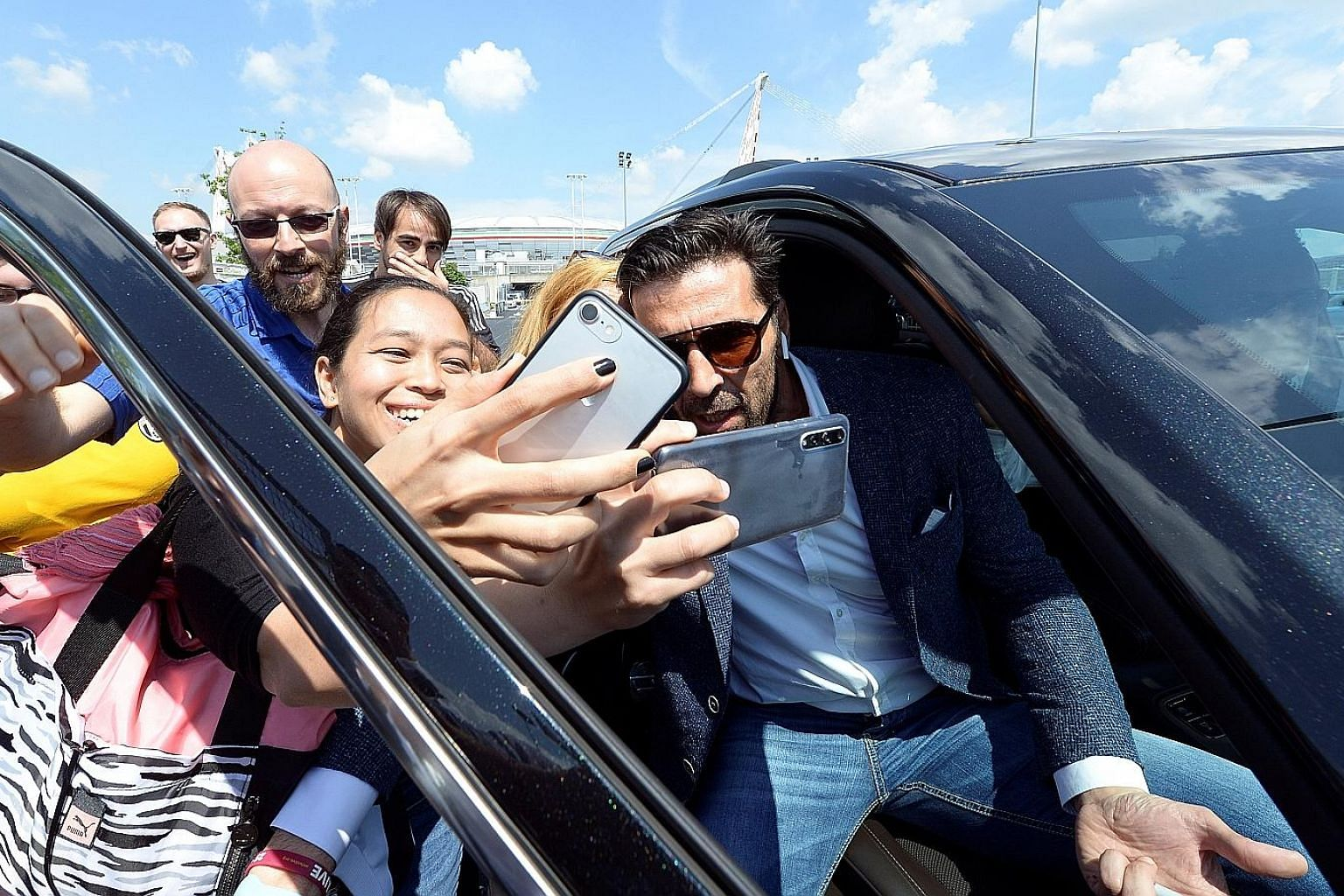 Juventus goalkeeper Gianluigi Buffon poses for pictures with fans in front of the Allianz Stadium after a news conference in Turin yesterday.