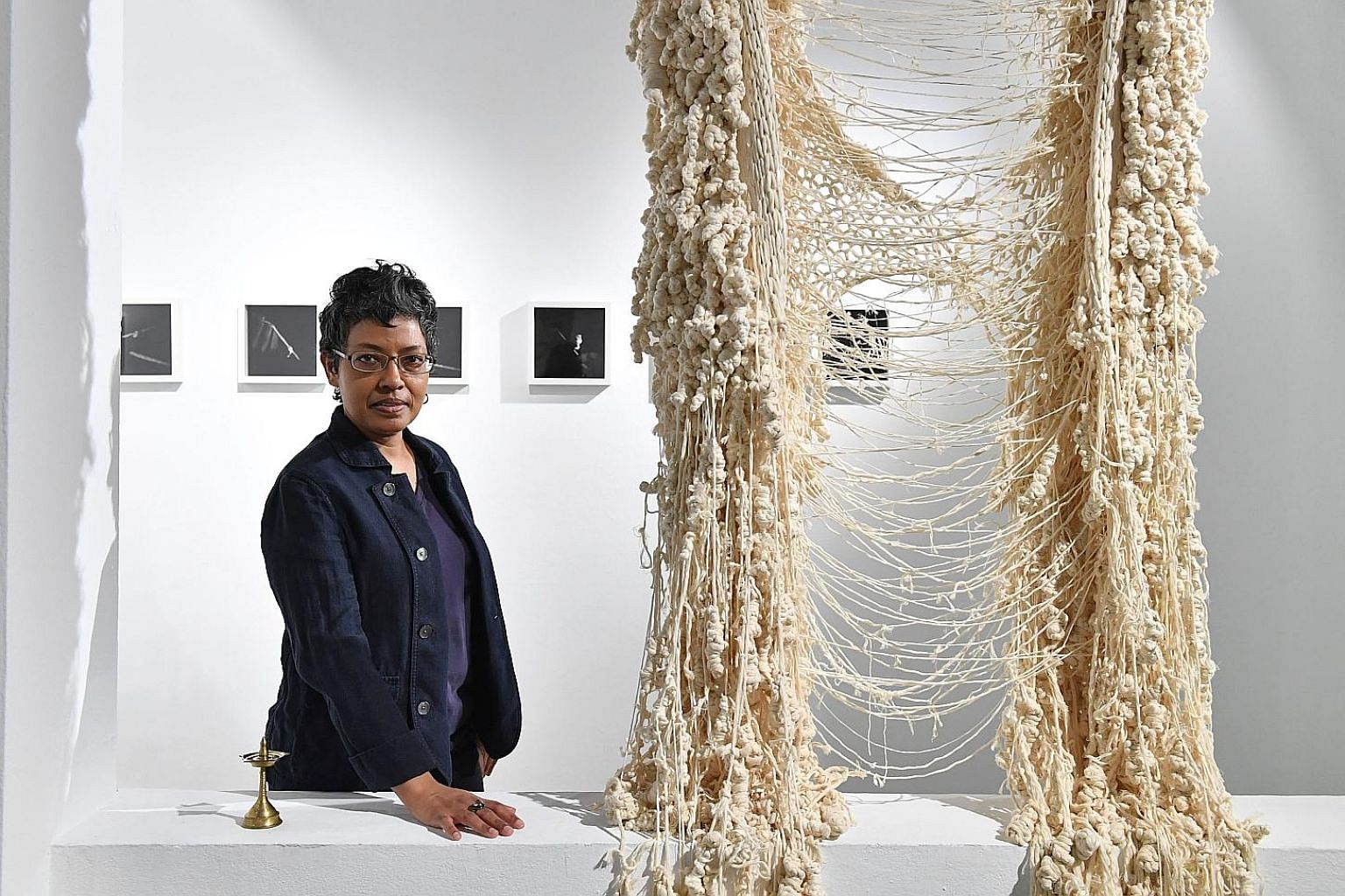 Dr Susie Lingham with India-based artist Mithun Jayaram's woven and knotted installation at the You, Other: I, Another exhibition.