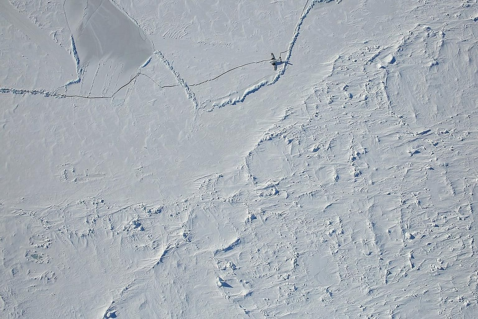A handout photo from Nasa showing remnants of a US Navy mission in the Arctic Ocean on April 8, seen during a survey flight for Operation IceBridge, Nasa's longest-running airborne mission to monitor polar ice change. The US Coast Guard's outgoing co