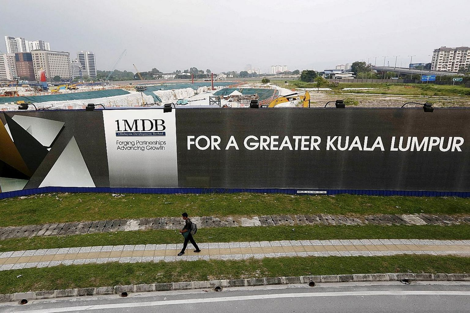 A 2015 photo showing the site for the Tun Razak Exchange, a planned financial district in Kuala Lumpur with aspirations of becoming Malaysia's Wall Street. The project was funded by 1Malaysia Development Berhad.