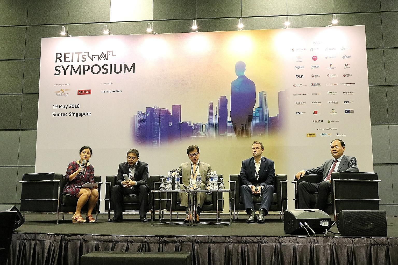 (From left) Ms Nupur Joshi, CEO of the Reit Association of Singapore; Mr Sanjeev Dasgupta, CEO of Ascendas India Trust's trustee-manager; Mr Anthony Ang, CEO of Sasseur Reit's manager; Mr Geoff Howie, Singapore Exchange market strategist, and Mr Goh
