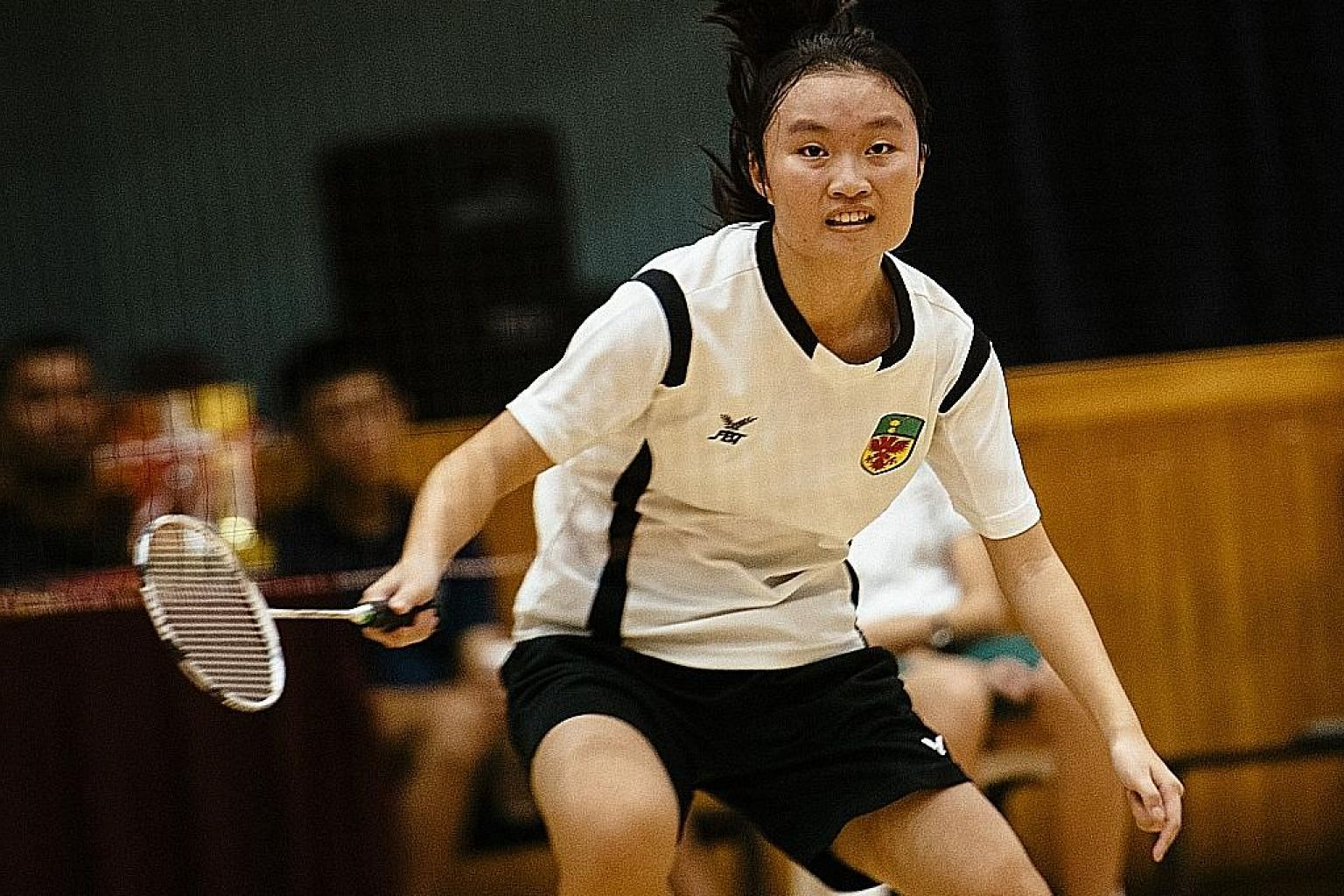 Arielle Koh (above) and Chew Wei Loon, seen celebrating with supporters, both contributed winning points to Raffles Institution's boys' and girls' teams. They completed the A Division badminton double for the third year running.