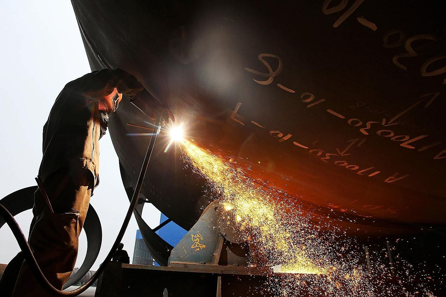 A worker welding steel at a shipyard in Nantong in China's eastern Jiangsu province. In March, US President Donald Trump announced plans to impose tariffs on Chinese imports - mainly steel and aluminium. Now, Washington and Beijing have agreed to sto