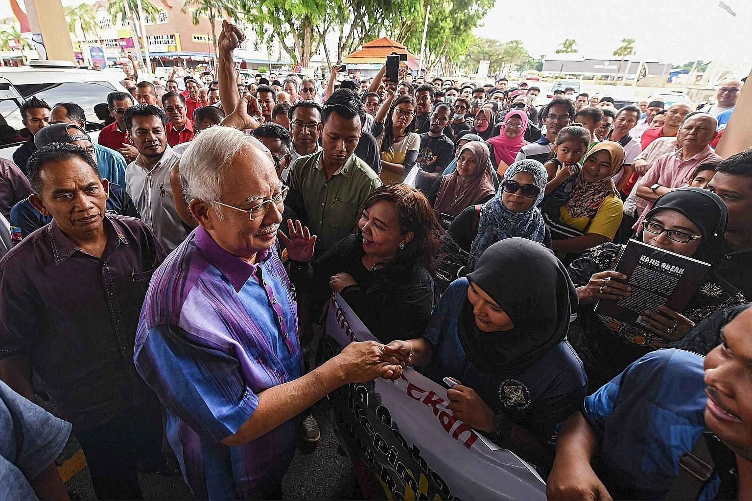 Datuk Seri Najib Razak meeting supporters at an event in Pekan, Pahang, on Sunday. The former Malaysian premier, who has been summoned to the Malaysian Anti-Corruption Commission today, is expected to be questioned about fund transfers amounting to m