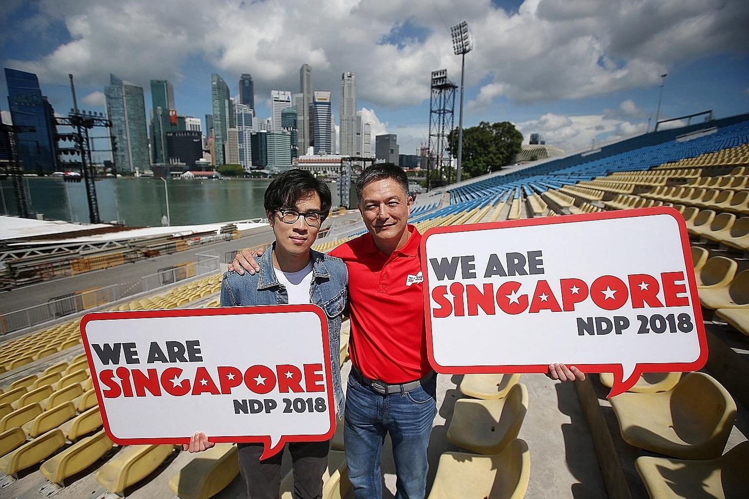 NDP 2018 executive committee chairman, Brigadier-General Alfred Fox (right), and singer Charlie Lim holding up this year's parade logo at the launch yesterday.