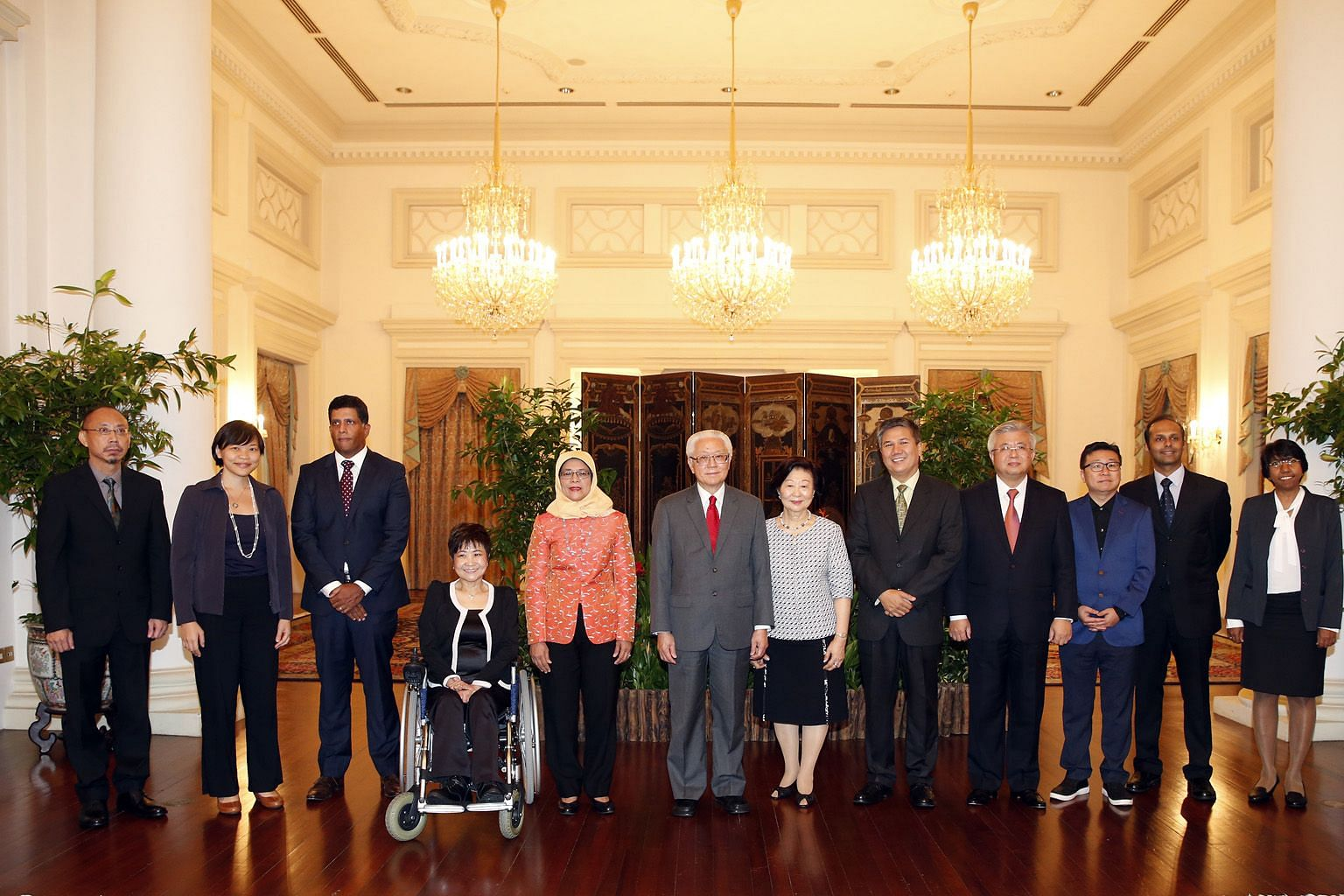 Then Speaker Halimah Yacob, then President Tony Tan Keng Yam, and his wife, Mary, being flanked by the current lineup of Nominated MPs after their appointment on March 22, 2016. (From left) Labour economist Randolph Tan; social entrepreneur Kuik Shia
