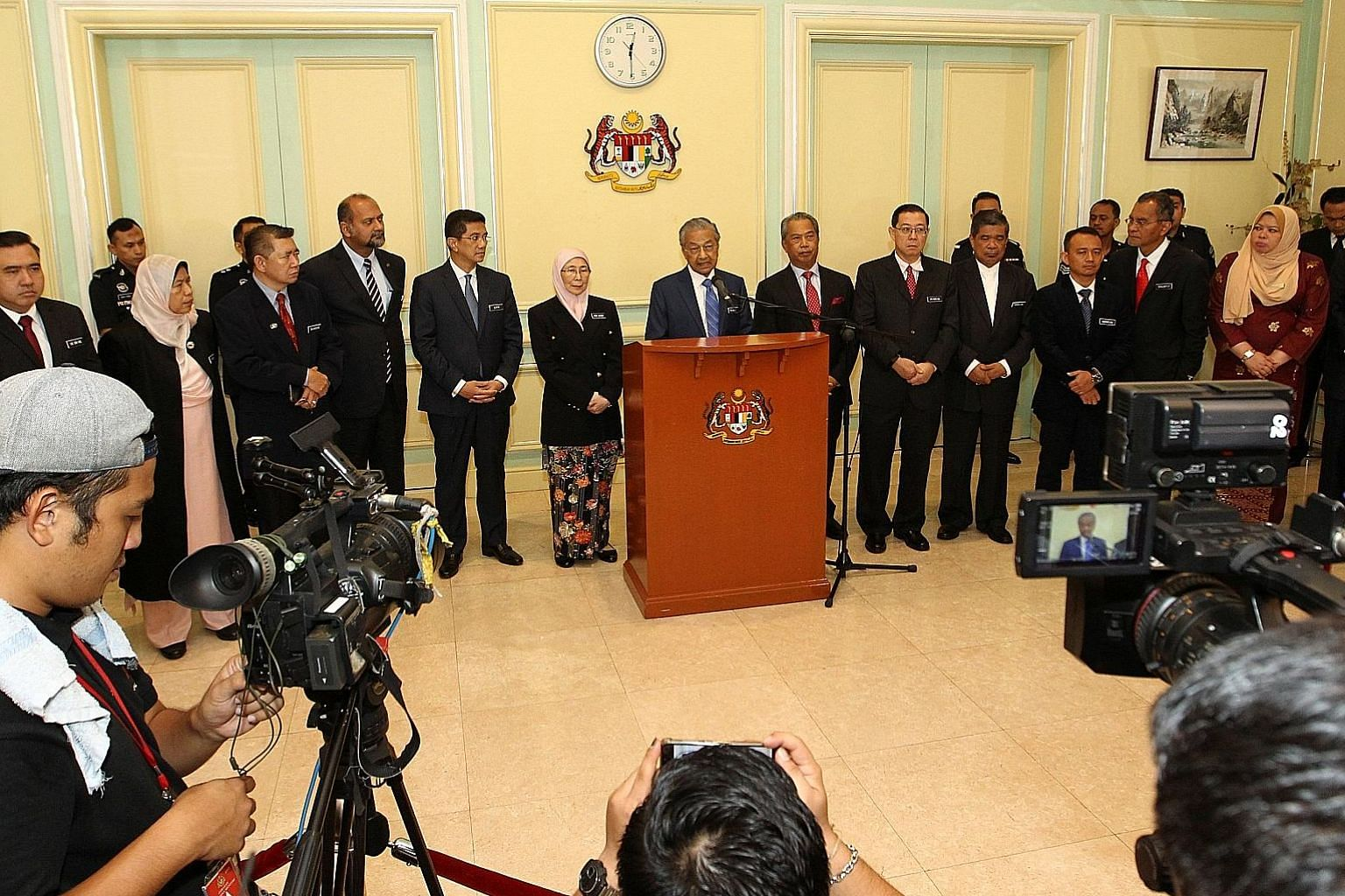 Malaysian Prime Minister Mahathir Mohamad, accompanied by his Cabinet members, giving a news conference after their meeting in Putrajaya yesterday. The government is grappling with a huge debt left behind by the previous administration.