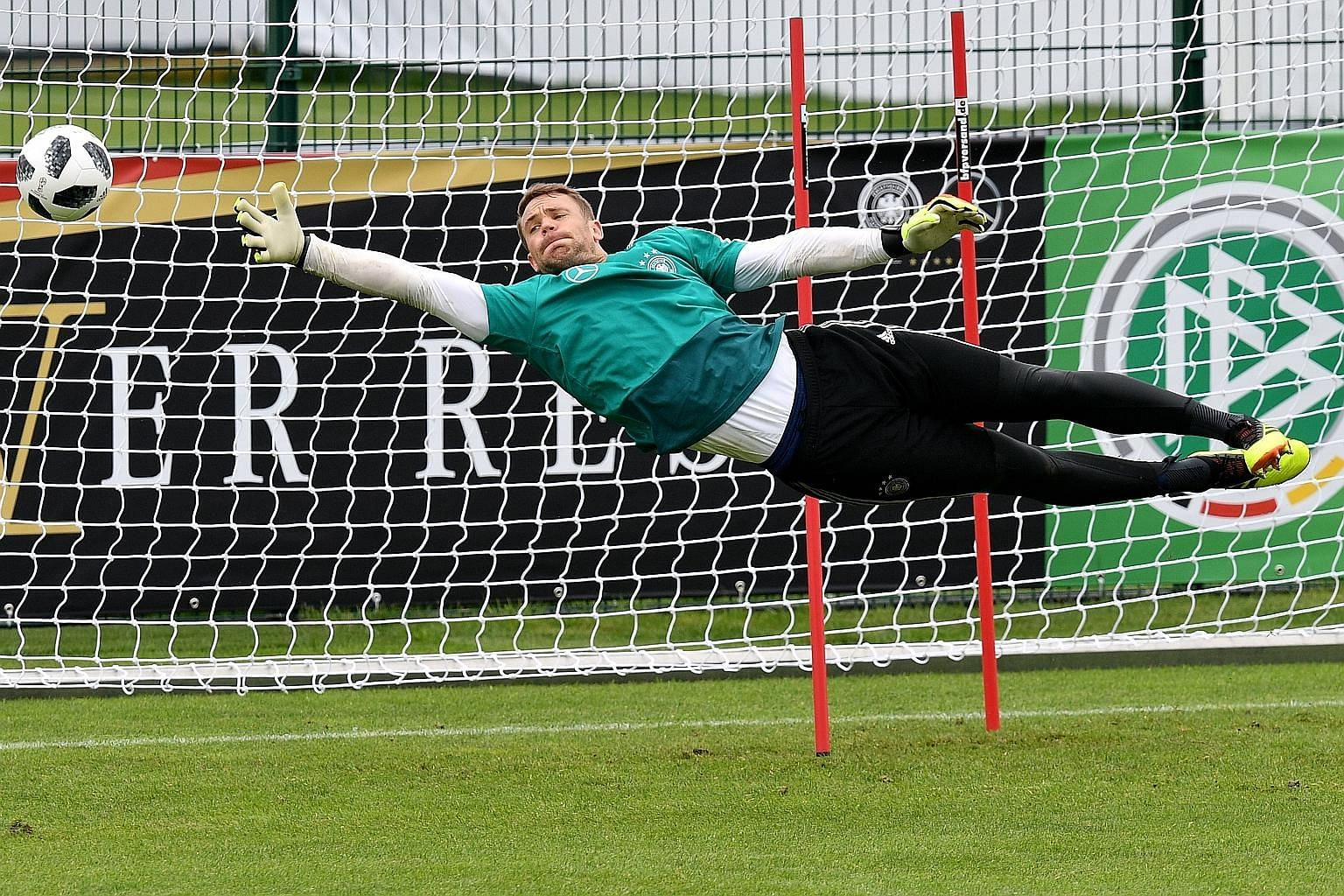 Germany goalkeeper Manuel Neuer participating in a training session in Eppan, Italy, yesterday. The 32-year-old captain has not played since breaking a bone in his foot in September but is now recovering after surgery.