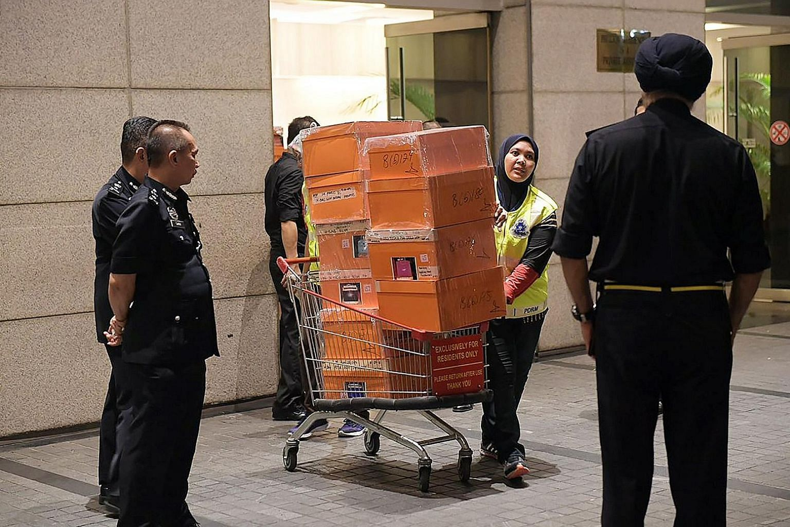 Malaysian police removing items in a raid last week from three apartments in an upmarket Kuala Lumpur condominium linked to former prime minister Najib Razak's family. The police carted away bags filled with jewellery, cash, watches and other valuabl