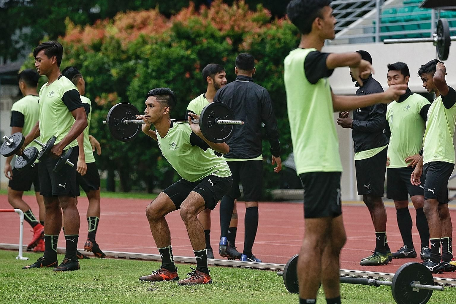 Home United defender Faizal Roslan lifting weights during a training session at Bishan Stadium on Wednesday. The Singapore Premier League side can move into the top half of the table with a win over third-placed Brunei DPMM FC today.
