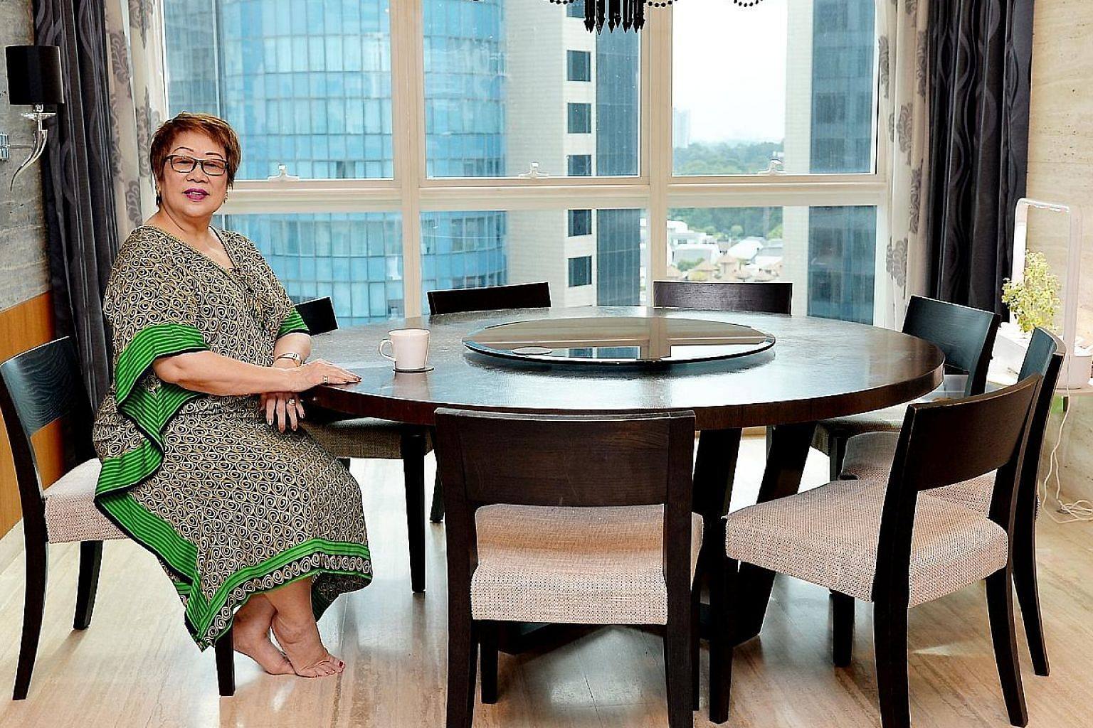 Businesswoman Greta Ng relaxing in her house, which boasts spectacular views. Besides Ganbanyoku Hot Stone Therapy spa at Far East Plaza, Ms Ng has a property portfolio including a 4,000 sq ft two-storey house in Bukit Timah Road and a 1,200 sq ft ap