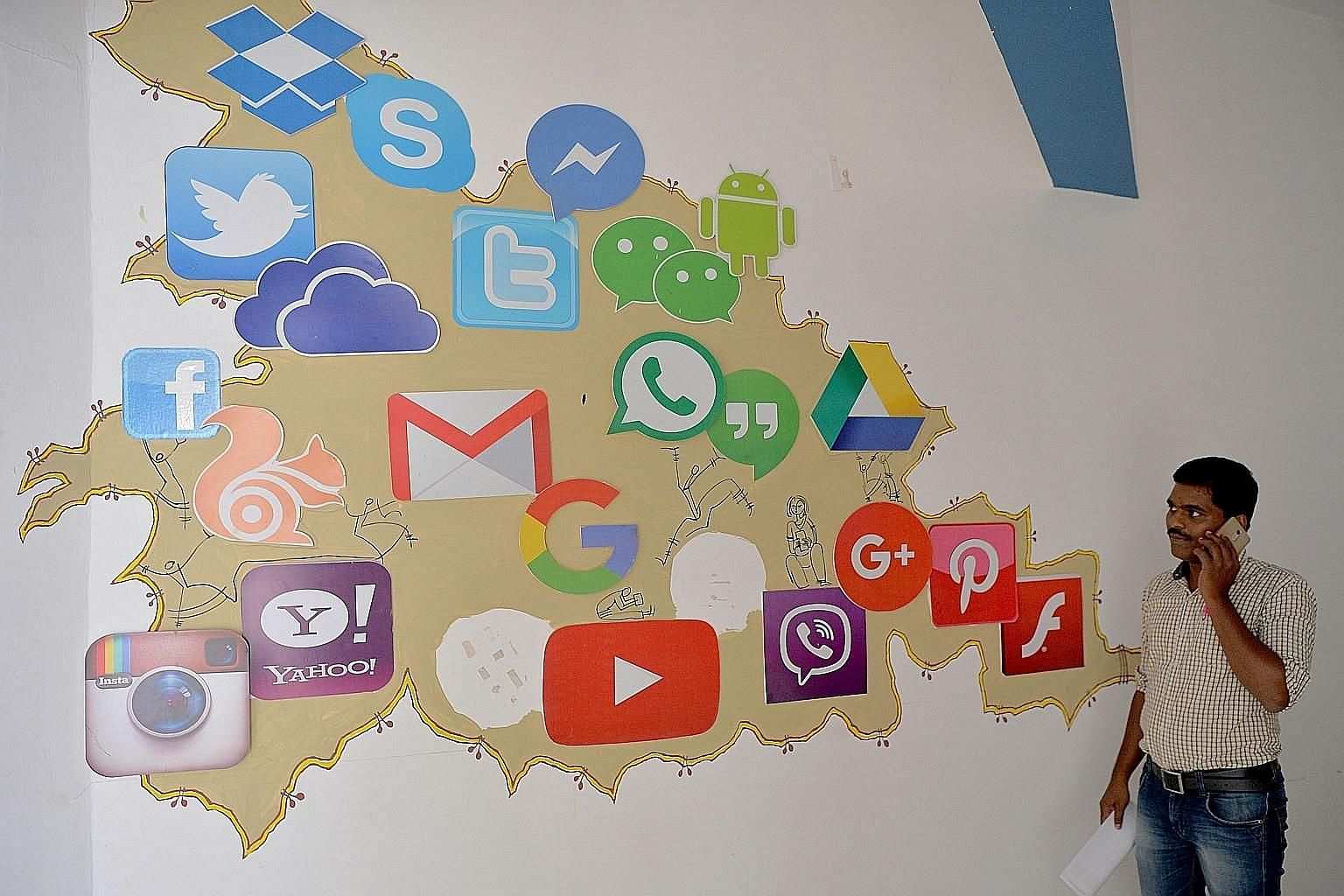 A mural in Bangalore depicting social media companies and chat apps. WhatsApp's largest market is in India, where it has more than 200 million users. But activists say the platform is rife for abuse because many of its users are new to the Internet a