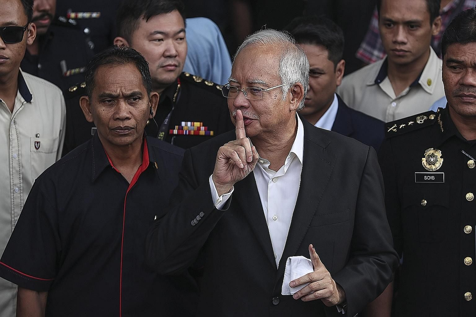 "Former Malaysian prime minister Najib Razak leaving the Malaysian Anti-Corruption Commission headquarters in Putrajaya on Thursday. The agency's chief, Datuk Seri Mohd Shukri Abdull, said he ""nearly died"" when first investigating 1Malaysia Developmen"