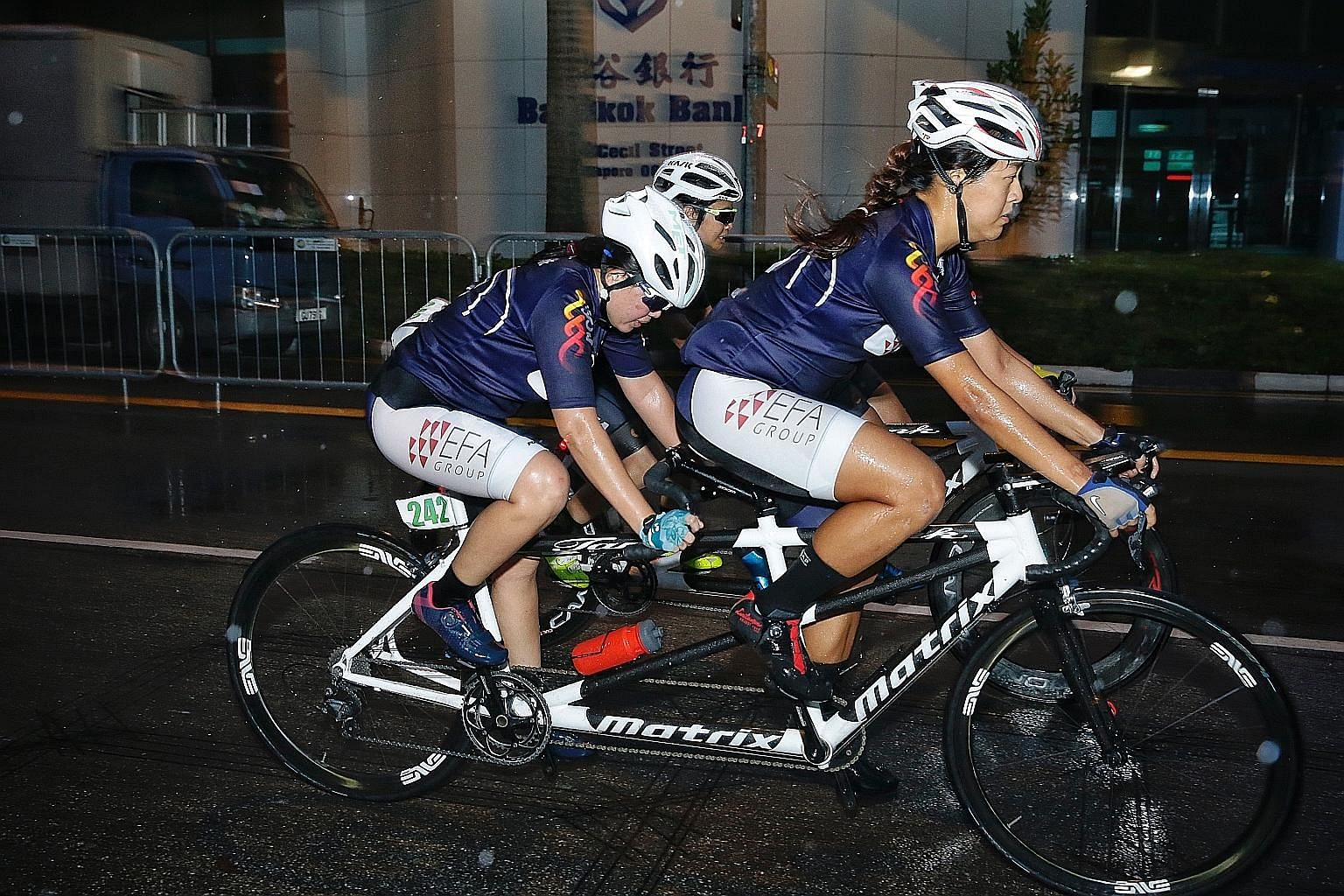 Para-cyclist Emily Lee and her sighted pilot Sarah Tan racing in tandem on the way to a bronze at yesterday's Singapore International Para-cycling Cup on Car-free Sunday. Being the first local race to be sanctioned by the UCI, participants could chal